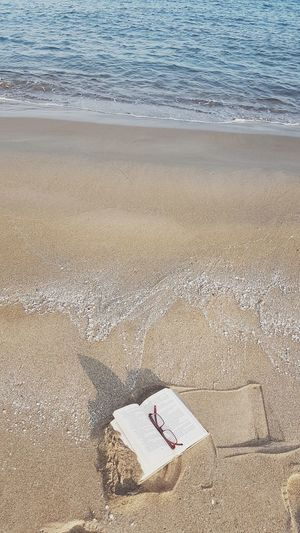 High angle view of book on beach