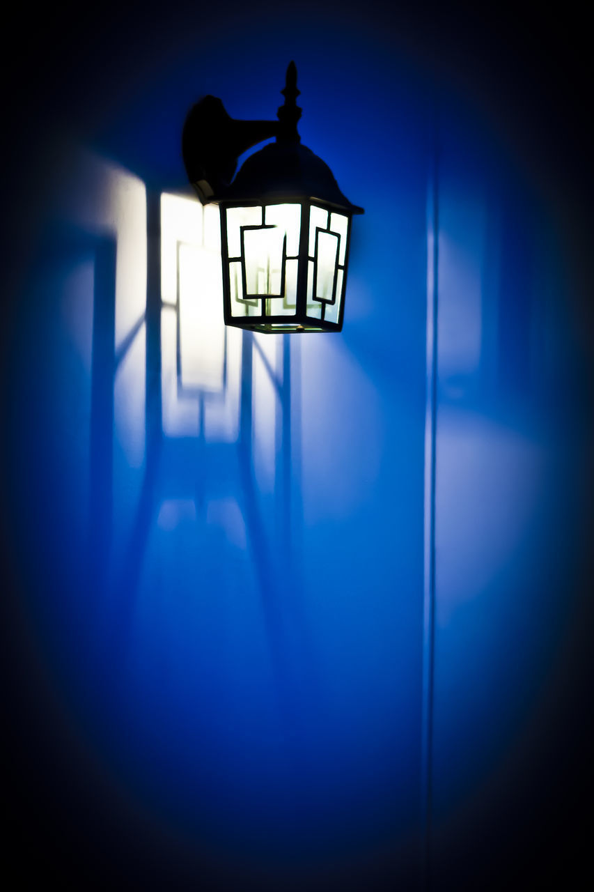 lighting equipment, illuminated, blue, indoors, architecture, electric lamp, light - natural phenomenon, no people, wall - building feature, built structure, dark, electricity, light, building, electric light, hanging, shadow, glowing, night, silhouette, light fixture