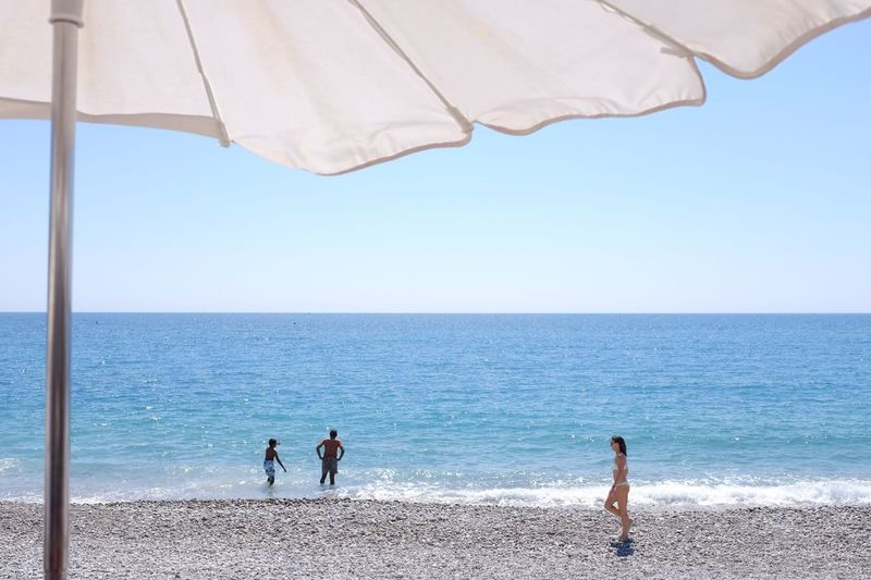 Sea Beach Horizon Over Water Water Nature Scenics Day Leisure Activity Tranquility Sand Togetherness Beauty In Nature Outdoors Clear Sky Summer Men Real People Blue Sky Vacations
