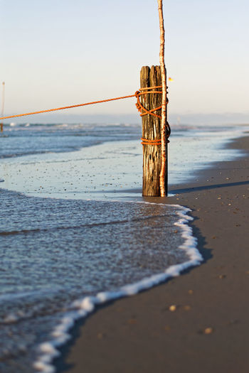 Wooden post by the ocean Sea Water Beach Land Nature Sand Outdoors Wood - Material Post Wooden Post Wave Coast Coastline Küste Holz Strand Wellen Shore Horizon Over Water Nordsee Meer Ocean Landscape