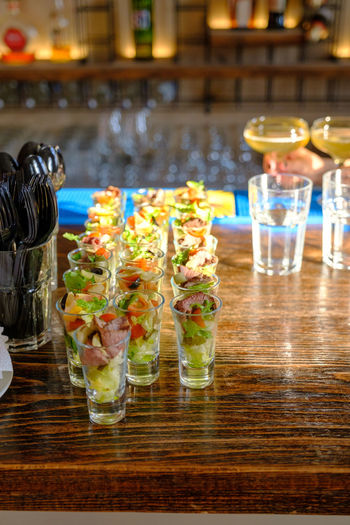 Food And Drink Table Food Glass Freshness Drink Refreshment Drinking Glass Ready-to-eat Indoors  Household Equipment Alcohol Restaurant Healthy Eating No People Plate Wood - Material Business Close-up Seafood Garnish Dinner Japanese Food