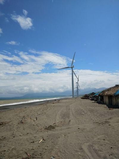 Windmill Wind Turbine Wind Power Technology Traditional Windmill Sea Beach Alternative Energy Fuel And Power Generation Blue