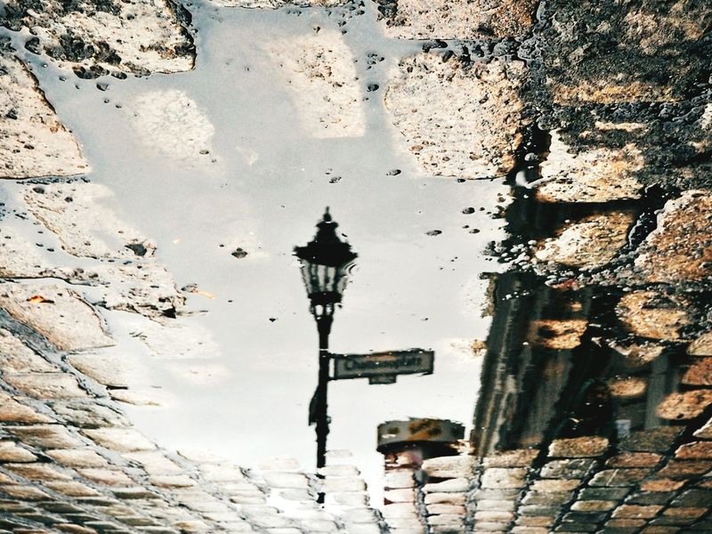 Reflection Puddle Puddleography Puddle Reflections Water Reflections Berlin Berliner Ansichten Cobblestone Streets Melting Snow Lamppost Mirrored Unusual Angle Kreuzberg Murky Water EyeEm Best Shots Eye4photography  Urbanphotography Capture Berlin