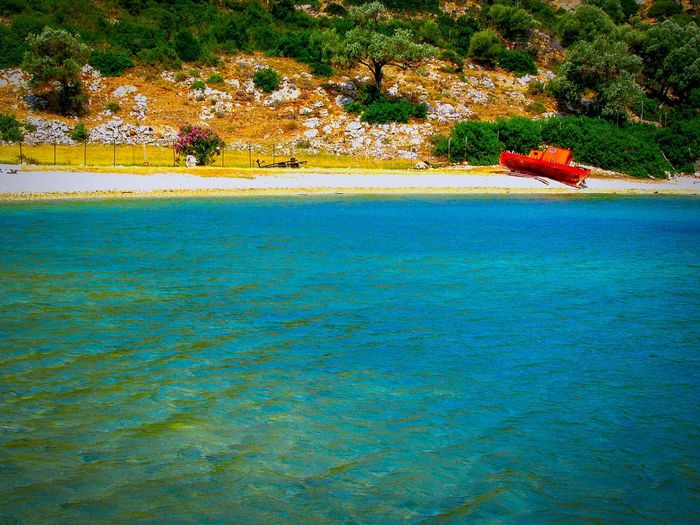 One Pic/2 Edits Red Boat Abandoned Boat Trawler Tranquil Scene Beach Beach Photography Pebble Beach Seascape Bay Gulf Old Boat Alonnisos Island Greek Islands Shades Of Red Abandoned Boat Shades Of Blue Landscapes Live For The Story The Great Outdoors - 2017 EyeEm Awards