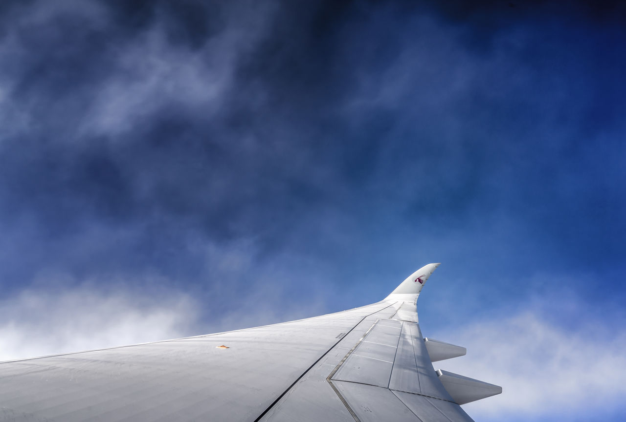 cloud - sky, transportation, airplane, sky, journey, mode of transport, airplane wing, day, no people, nature, flying, outdoors, beauty in nature, travel, blue, aircraft wing, mid-air, air vehicle, scenics
