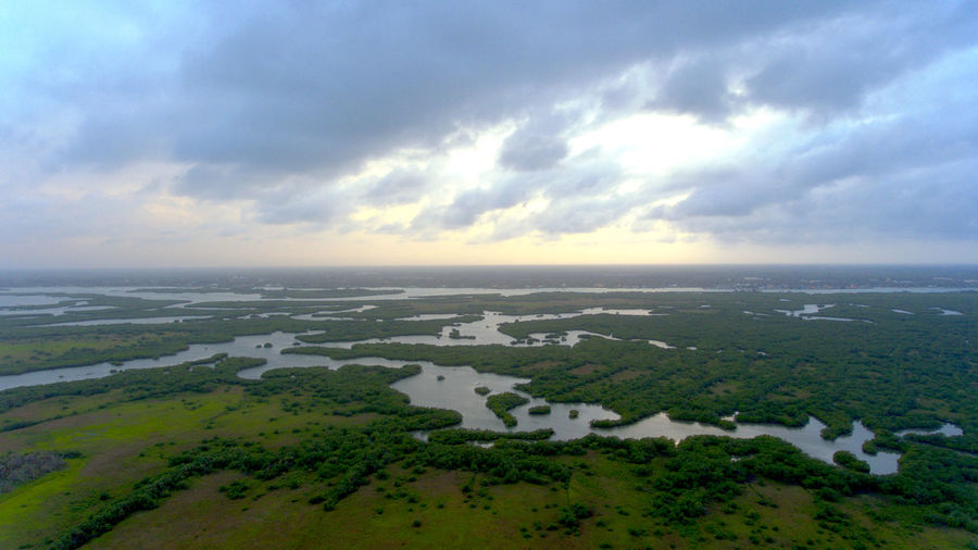 Calm over marshlands Aerial View Beach Beauty In Nature Cloud - Sky Day Horizon Over Water Landscape Nature No People Outdoors Scenics Sea Sky Tranquility Water Flying High The Great Outdoors - 2017 EyeEm Awards The Great Outdoors - 2017 EyeEm Awards
