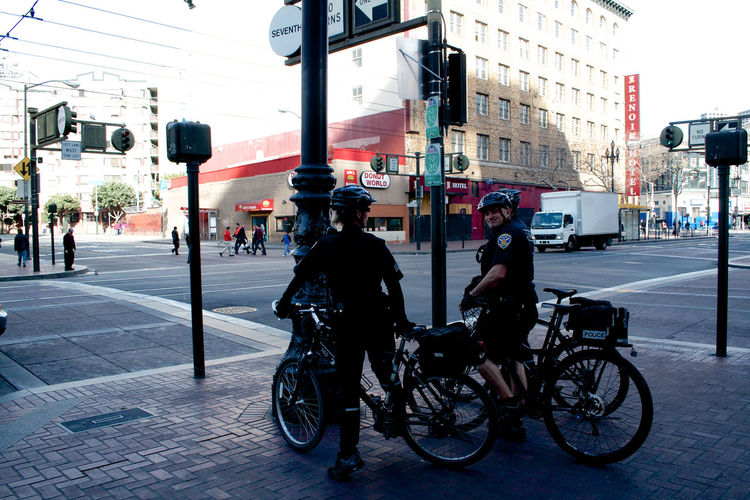 Architecture Bicycle Building Exterior Built Structure Car Casual Clothing City City Life City Street Cycling Land Vehicle Lifestyles Men Mode Of Transport On The Move People And Places Person Rear View Riding Road San Francisco Street Transportation Travel Travel Destinations