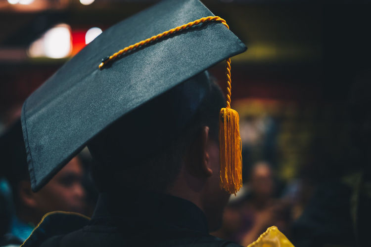 undergraduate hat One Person Clothing Real People Focus On Foreground Headshot Rear View Lifestyles Men Portrait Holding Day Unrecognizable Person Outdoors Close-up Leisure Activity Protection Academy School Achievement Graduation Graduate Academic Gown Attire Fashion Student Backgrounds Selective Focus Isolated Tassel Hat Black Orange Color Yellow People Young Man Toga Rear View Undergraduate Learning Study University March Completed Ceremony Exercise Honor Satin Garment Textile