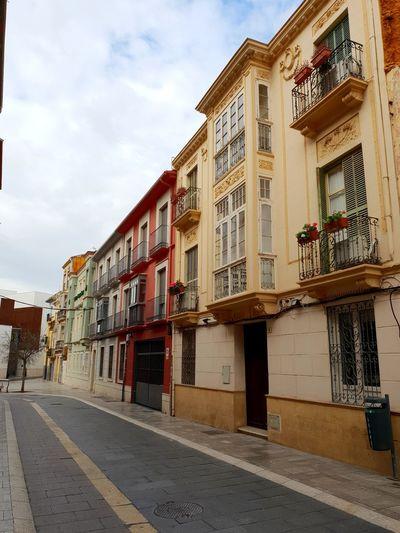 Residential buildings by street in city