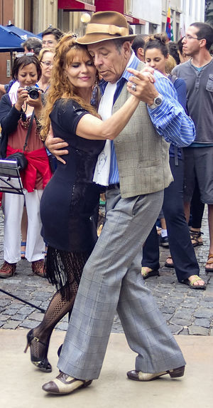 middle age women and an old man dancing cheek to cheek Tango in San Telmo, Buenos Aires, in front of tourists Cheek To Cheek Dancing San Telmo Tango Streetdancing Crowd Happiness Old And Young Passion Real People San Telmo, Buenos Aires Tango Tangoargentino