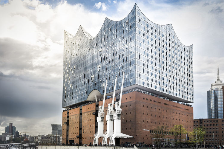We had typical weather conditions in Hamburg. It was cloudy with a chance of rain and sunshine. But Elphi was just fine with it and presented itself in perfect mood. Architecture Building Exterior City Cityscape Cloud - Sky Concert Hall  Elbphilharmonie Elphi Hafencity Hafencity Hamburg Hamburg Hamburger Hafen Kaispeicher Kran Modern Outdoors Sky Skyscraper Sunshine Travel Destinations