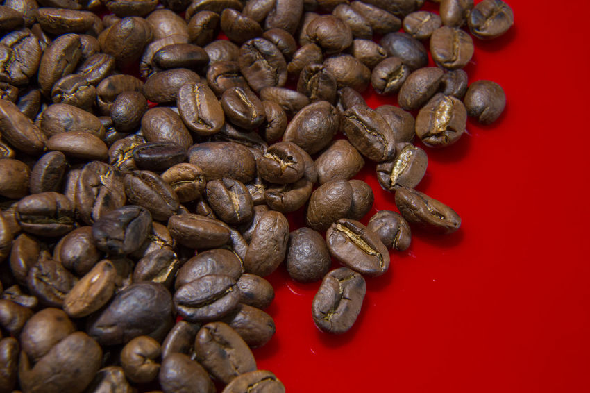 The Roasted Coffee Beans red background macro close up image for coffee background. Roasted Coffee Beans Coffee Beans Baker Coffee Beans Roasted Brown Close-up Coffee Bean Coffee Beans Coffee Beans For Sale Coffee Beans Roaster Food Food And Drink Freshness Healthy Eating Indoors  Large Group Of Objects No People Raw Coffee Bean Roasted Roasted Coffee Roasted Coffee Bean Still Life