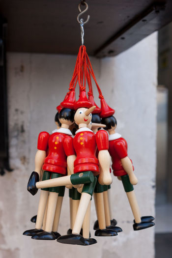 Europe Gubbio Italia Italy Umbria Long Buy Italian Present Pinocchio Shop Character Famous Culture Nose Figure Traditional Dolls Marionette Figurine  Objects Painted Boy Group Rome Kid Handmade Puppet Liar Red Souvenir Symbol Pinochio Lie Toys Funny Classic Old Wooden HERO Grow Wood To  Tale  Story Toy Background Object Board Dream