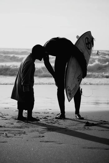 Full length of men standing on beach