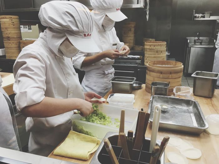 Commercial Kitchen Real People Occupation Food And Drink Establishment Indoors  Food And Drink Preparation  Working Food Preparing Food Chef Uniform Food And Drink Industry Standing Skill  Men Freshness One Person Healthy Eating Day