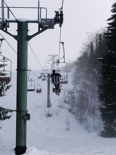 Ski lift over snow covered field