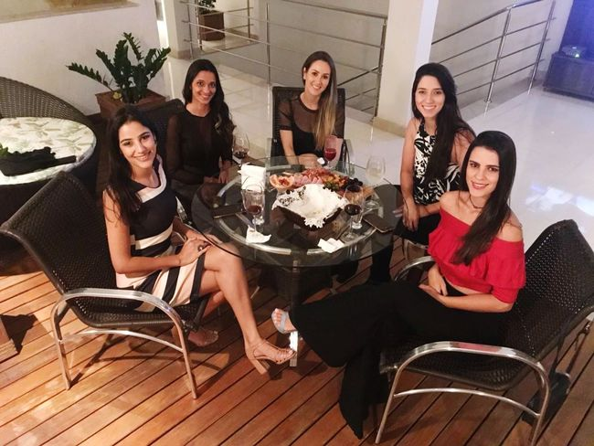 Friendship Young Women Portrait Sitting Party - Social Event Smiling Looking At Camera Table Women Group Of People