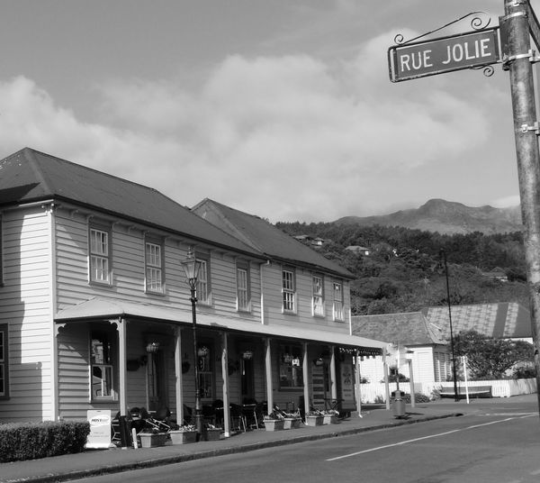 Quaint Buildings of Akaroa New Zealand- French Influence Akaroa Amazing Places To See Beautiful Blackandwhite Photography Cute Houses French Influence Houses Near Christchurch New Zealand Old House Originally French Quaint  Quaint Village South Island New Zealand Streets Tourism Travel Destinations Travel Photography Vacation What A Spot!