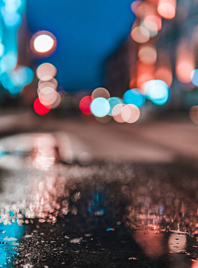 Illuminated Night City Street Architecture No People Glowing Building Exterior Selective Focus City Life Defocused Lens Flare Transportation Built Structure Outdoors Lighting Equipment Motor Vehicle Close-up Car Circle Cityscape Nightlife Digital Composite Surface Level
