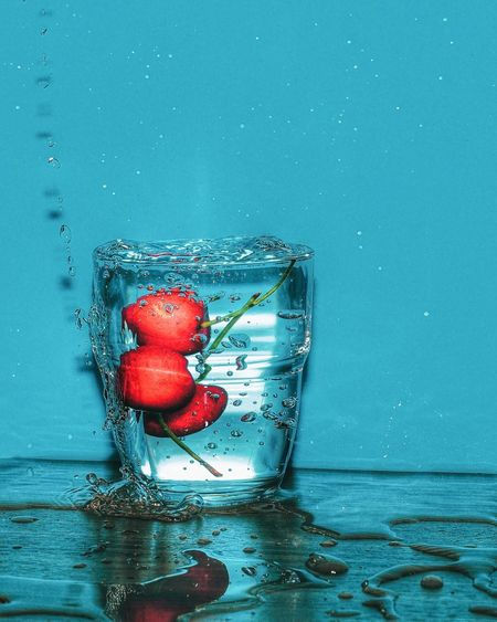 Close-up of red cherries in water