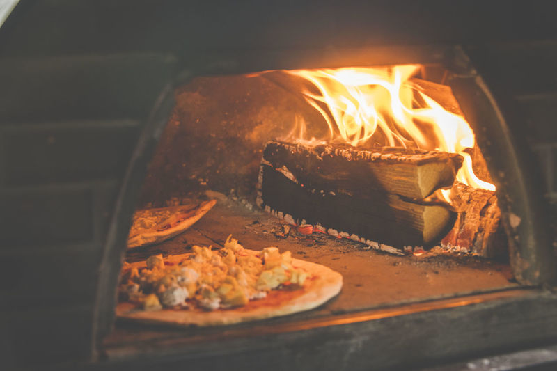 Pizza in the oven Food Pizza Baking Fire Wood OpenEdit Hot Flame Flames Burning Oven Still Life No People Close-up Heat - Temperature Baked Preparation  Selective Focus Food And Drink