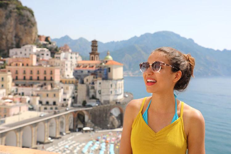 Woman standing by sea at amalfi coast