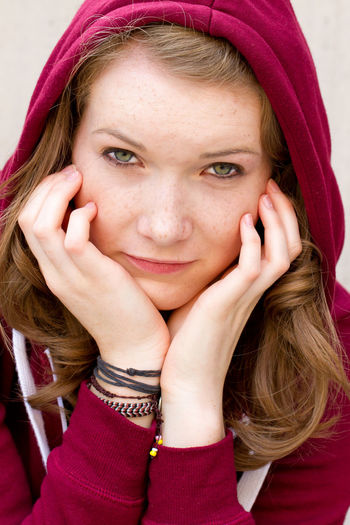 Close-Up Portrait Of Young Woman In Hood - Clothing