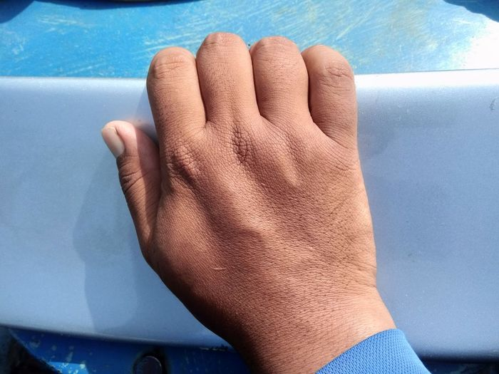 Midsection of person with hands