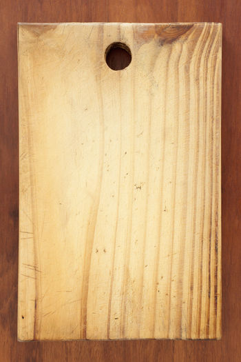 My Mom's Cutting board. Top view of wooden cutting board over kitchen table. Cooking Cooking Utensil Cutting Board Detail Directly Above Domestic Kitchen Food And Drink Full Frame Indoor Kitchen Counter Kitchen Utensils Mama Cutting Board No People Old Cooking Utensils Photography Preparation  Rusty Simplicity Studio Photography Studio Shot Textured  Vertical Wood Wood - Material Wood Grain Wood-material Wooden