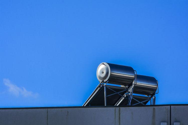 Metallic structure against blue sky