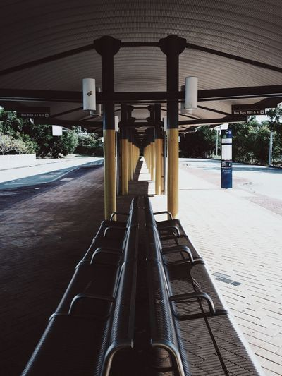 High Angle View Of Bench At Bus Station