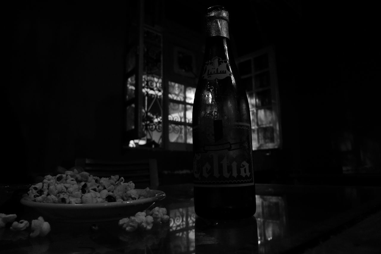 table, indoors, food and drink, no people, bottle, container, still life, food, glass, glass - material, plate, selective focus, household equipment, transparent, bowl, drink, refreshment, freshness, drinking glass, alcohol