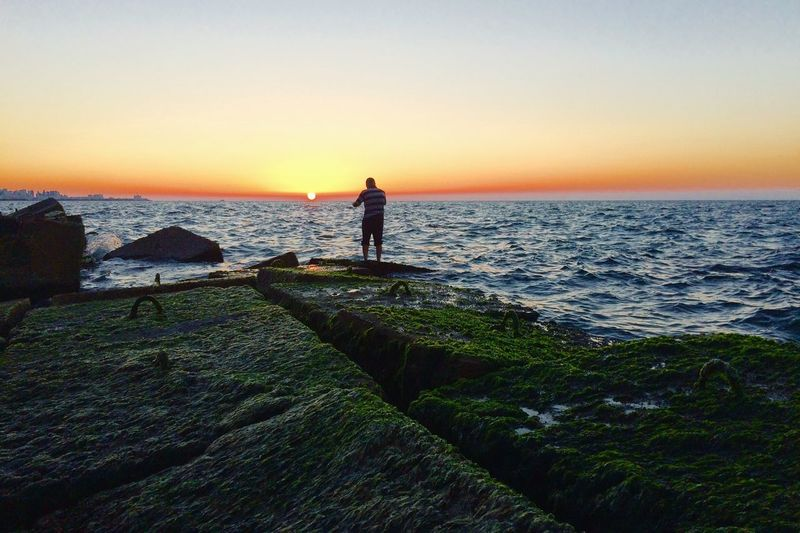 The beauty of sunset with a fishing man. Sea Sunset Horizon Over Water Water Scenics Nature Tranquil Scene Beauty In Nature Fishing Clear Sky Sky first eyeem photo