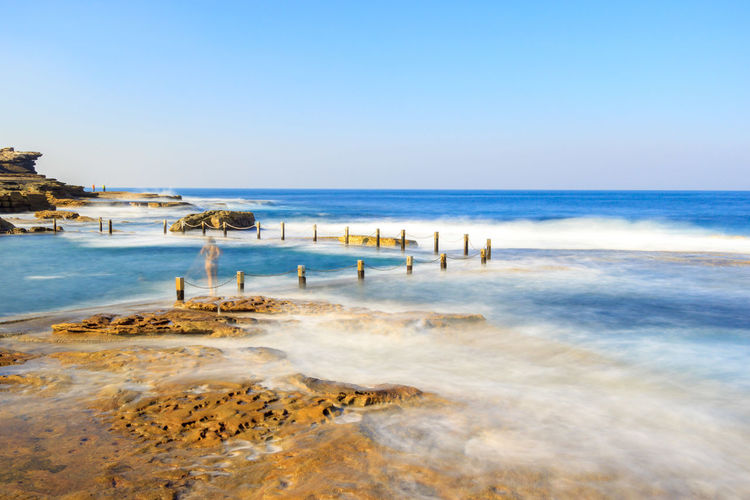 Extended exposure of waves smashing into Mahon rock pool Rock Swimming Beach Beauty In Nature Clear Sky Day Horizon Over Water Mahon Pool Nature Outdoors People Pool Rock Pools Scenics Sea Sky Swimming Pool Travel Destinations Water Wave