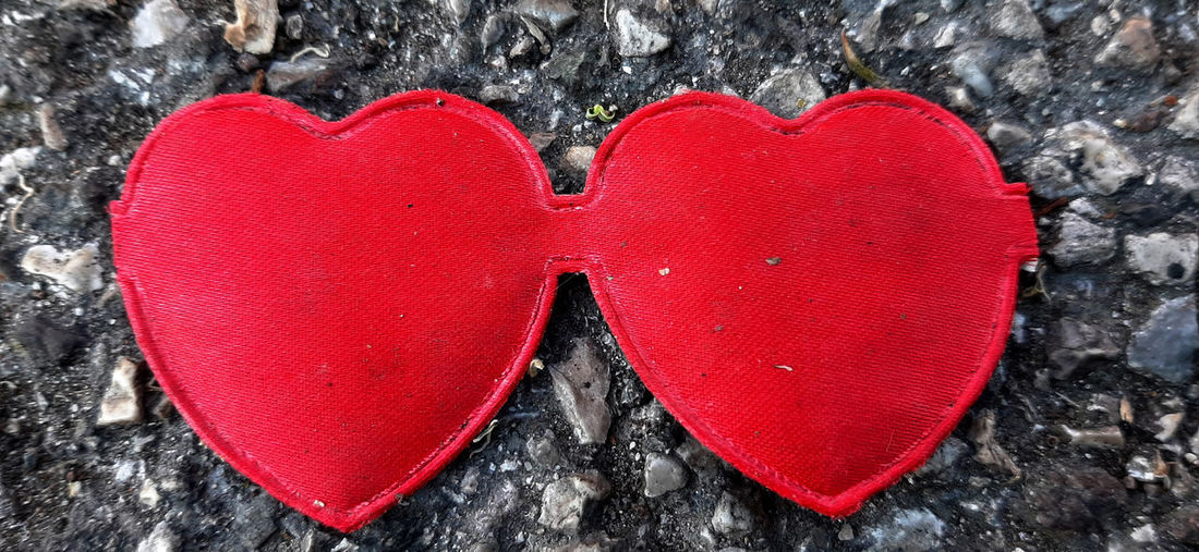 Close-up of red heart shape on wall