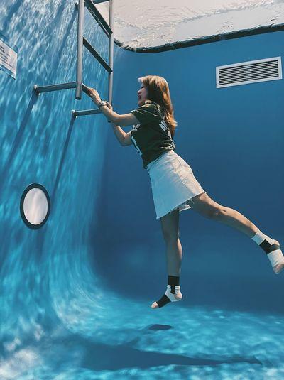 Woman exercising in swimming pool