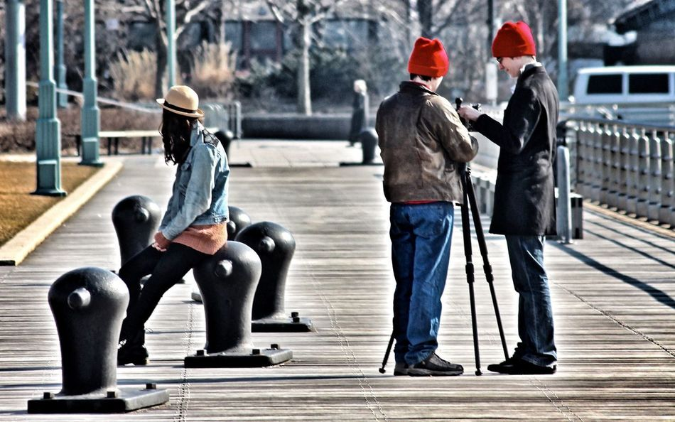 Full Length Adults Only Real People People City Headwear Adult Day Togetherness Girl And Boys NYC Street Photography NYC Photography New York Streetphotography Pier Street Photography Modelling Waiting Red Head Red Hat EyeEmNewHere The Street Photographer - 2017 EyeEm Awards