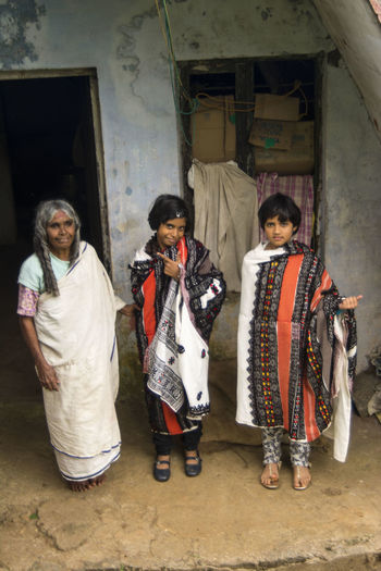 Old tribal lady with guests_kids Bonding Front View Guests Here Belongs To Me Looking At Camera Old Tribal Lady Poor  Togetherness Traditional Costume Traditional Culture Tribal Costume