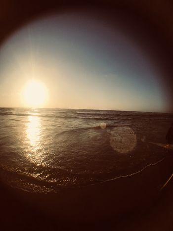Sky Water Sea Sunset Scenics - Nature Beauty In Nature Horizon Horizon Over Water Beach Tranquility Tranquil Scene Land Sun Sunlight Nature Idyllic Reflection Lens Flare Sunbeam No People