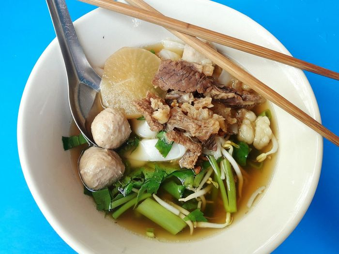 Eat like an asian! Food And Drink Plate Food Bowl Healthy Eating No People Indoors  Anise Freshness Close-up Ready-to-eat Day Meatballs Vegetables Flat Noodles Thai Cuisine Thai Food Chopsticks Blue Background Phone Photography Food Photography Food Stories