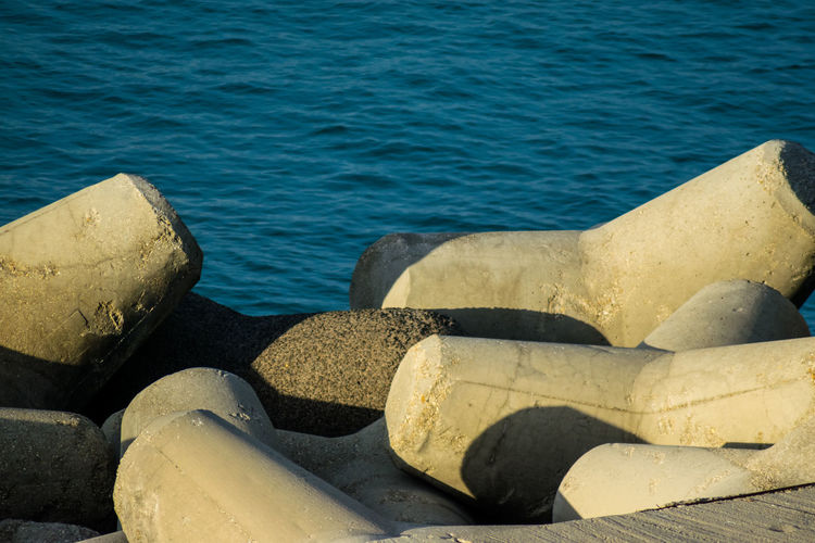 Close-up of rocks by sea