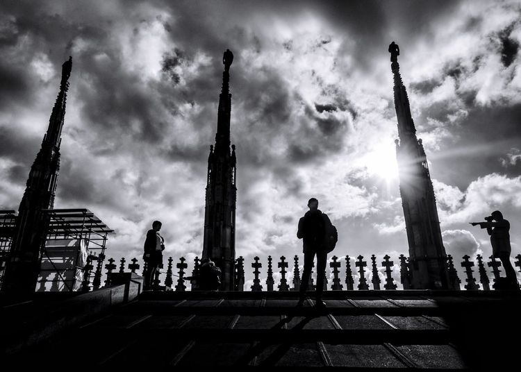 The chosen one // Duomo di Milano // Nov'16 Sky Cloud - Sky Building Exterior Architecture Spirituality Streetphotography Candid Milano Italy Silhouette Backlight Olympus Mirrorless
