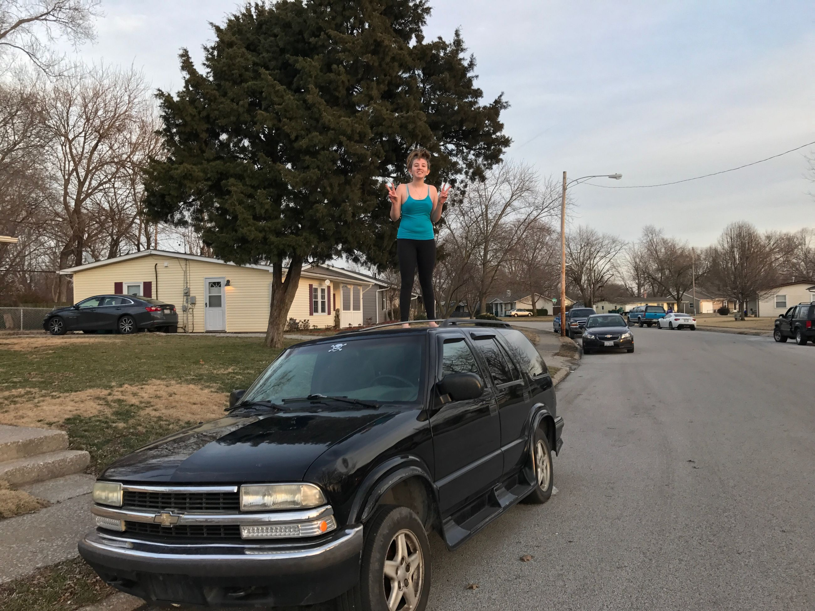 car, tree, transportation, stationary, police force, mode of transport, only men, adults only, sky, outdoors, one person, day, people, adult