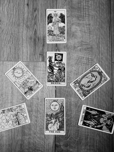 Tarot Tarotcards Art And Craft Text High Angle View Multi Colored Indoors  Table Communication Wood - Material No People Paper Close-up Day The Week On EyeEm