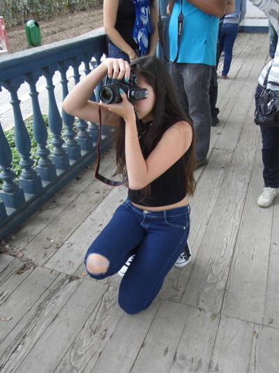 Young girl in her photograph lessons 20-24 Years Black Blue Jeans Casual Clothing Caucasian Girl Lifestyles Lima Person Peru Photographer In Action Photography Student Wooden Floor Young Women