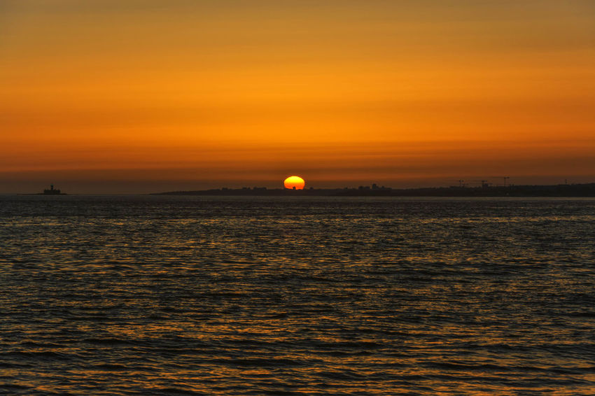 Beauty In Nature Costadecaparica Horizon Over Water Moon Nature No People Orange Color Outdoors Scenics Sea Sky Sun Sunset Tranquil Scene Tranquility Travel Destinations Water Waterfront