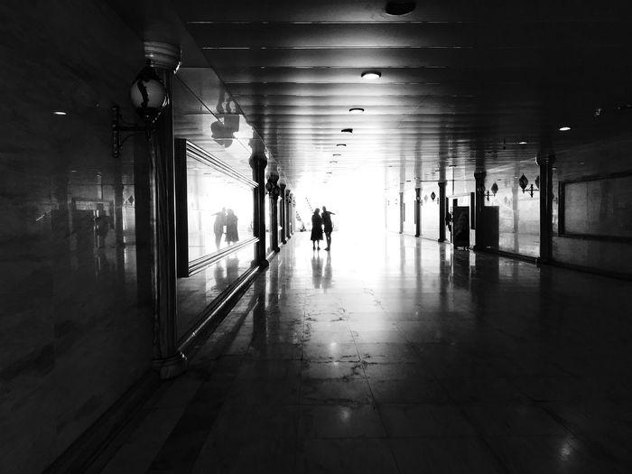 People walking in subway building