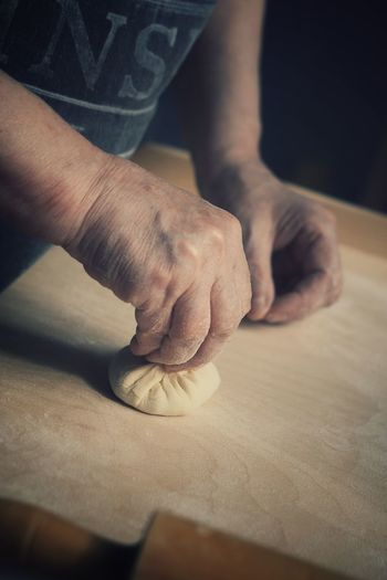 Midsection Of Person Making Dumpling