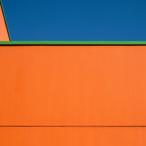 Blueskybuildingdetail Architecture Blue Built Structure No People Fujix_berlin Ralfpollack_fotografie Minimalism Minimal Orange Color Copy Space Backgrounds Wall - Building Feature Outdoors Sky Day Full Frame Orange Abstract Building Exterior Pattern Clear Sky