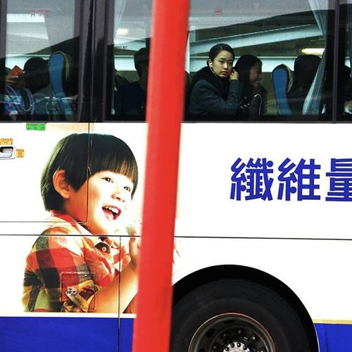 Smile! you bus rider HongKong Bus Transportation Smile Girl Commercial NgongPing Canon Tourist Streetart People Girl Bestoftheday Picoftheday Visithongkong DigitalRev @klikarbain